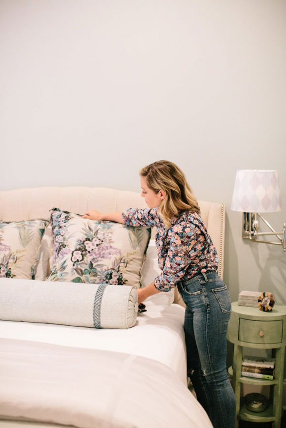 lindsey cheek of gathered interior design fluffing pillows