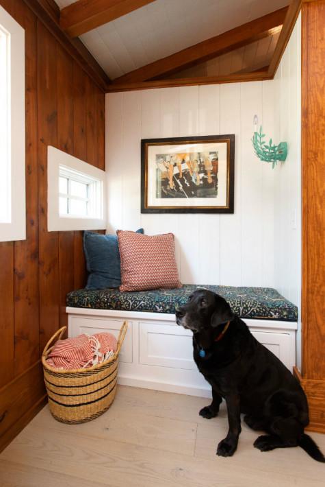 black-lab-dog-bench-seat-gathered-group