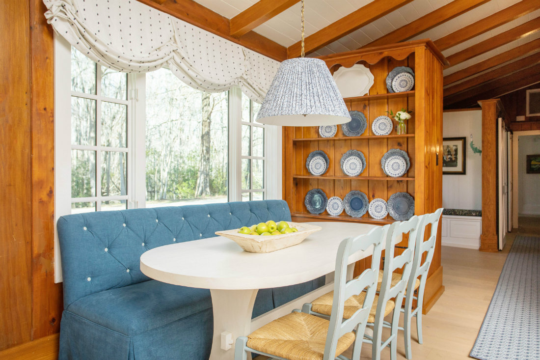 blue-fabric-couch-seating-at-table