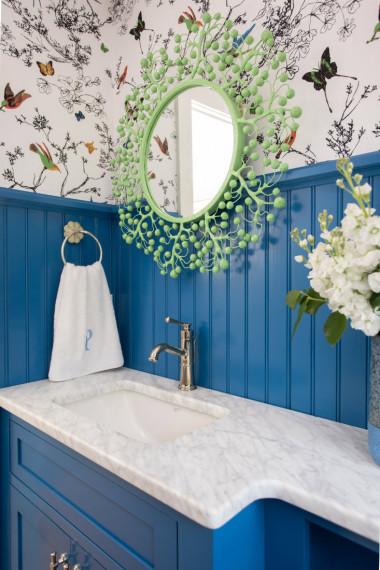 blue-wood-panel-behind-bathroom-sink-wreath-mirror