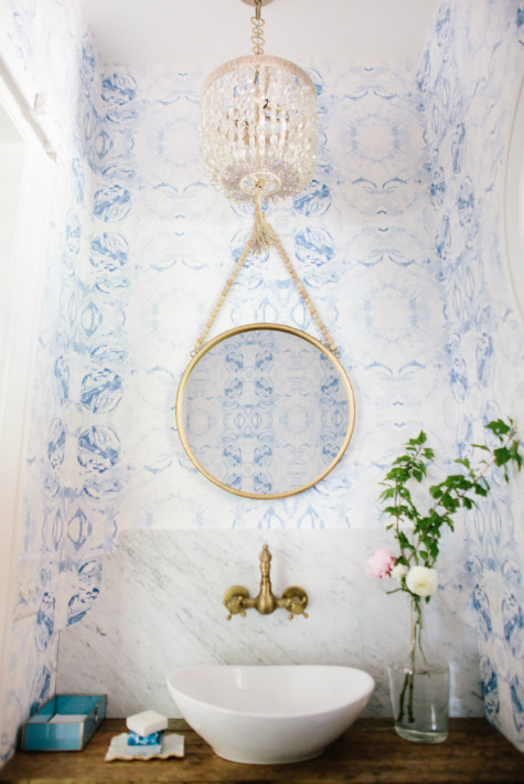 hanging-round-circle-mirror-gold-accents-bathroom