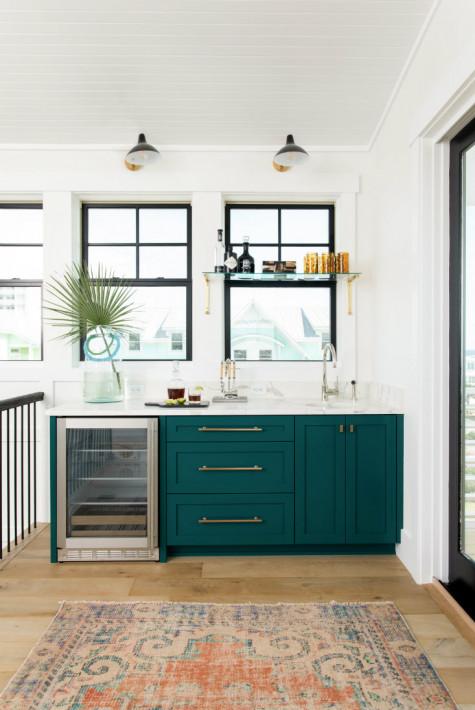 indoor-wet-bar-sink-mini-fridge-green-cabinets