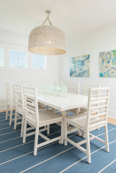 white-dining-table-chairs-striped-blue-carpet
