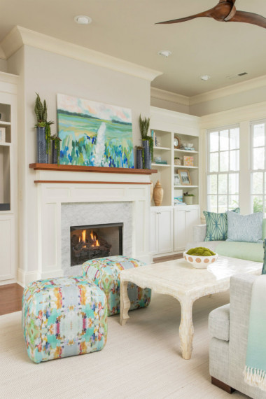 white-fireplace-wooden-mantle-art-colorful-ottomans