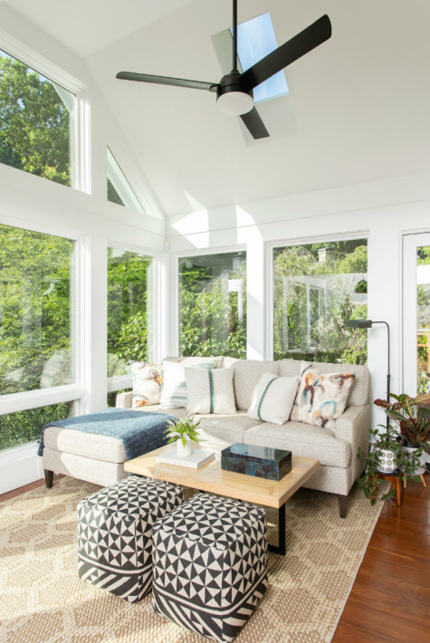 sunroom-couch-sitting-area-large-windows-natural-sunlight-nc