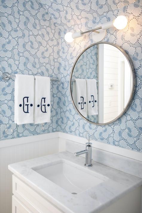 bathroom-design-round-mirrow-blue-white-floral-wallpaper